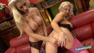 Two gorgeous babes with big boobs experiment their lesbian side on the sofa